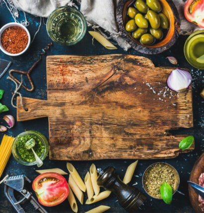 A cooking board with various vegetables.