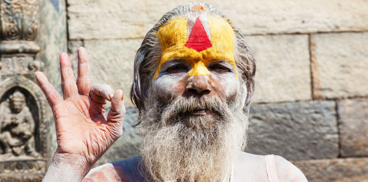 A man in Asia wearing traditional face makup.