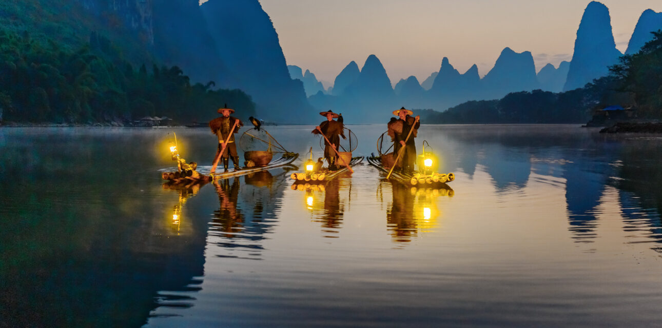 people riding boats in Asia.