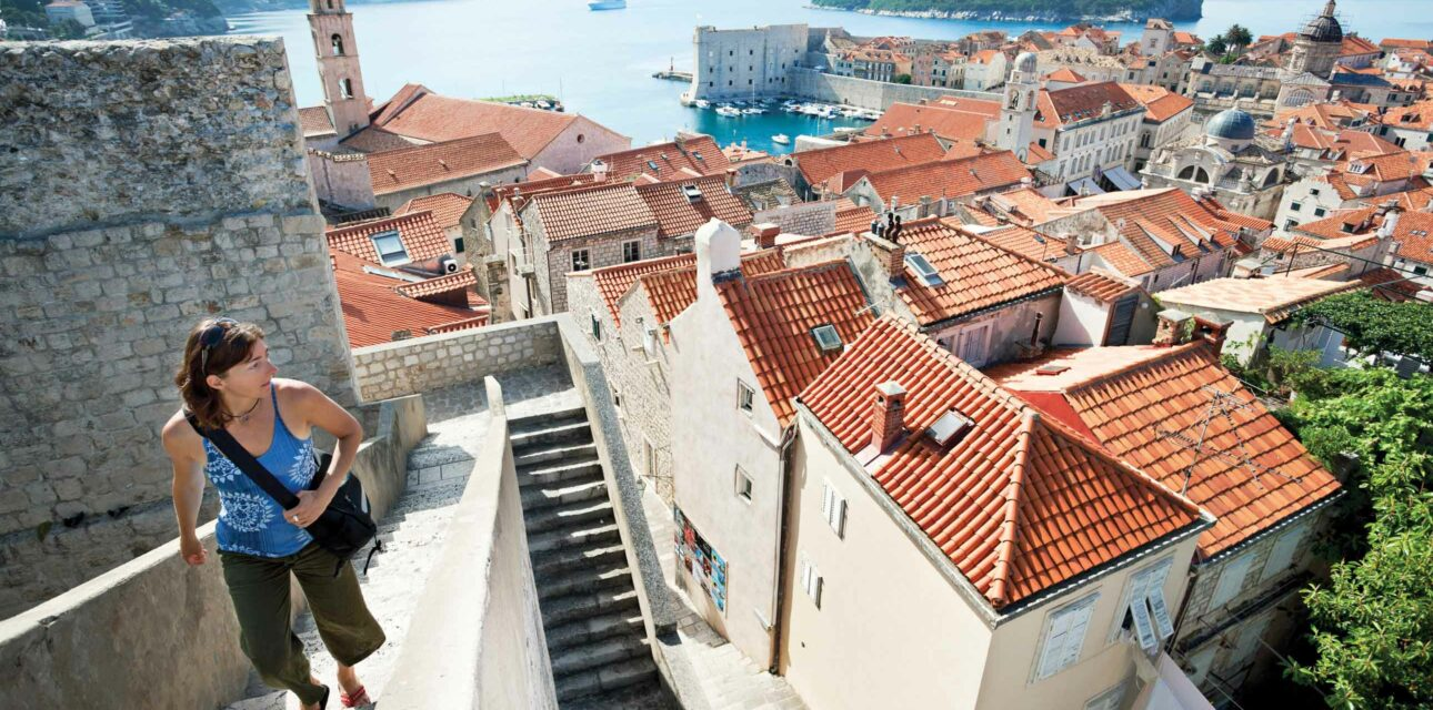 A woman walking up stairs in Croatia