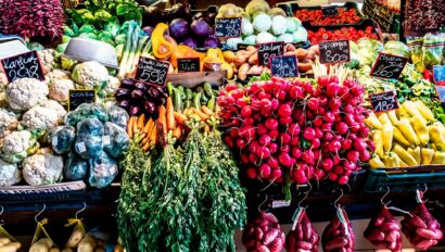 An open market showing various colorful vegetables.