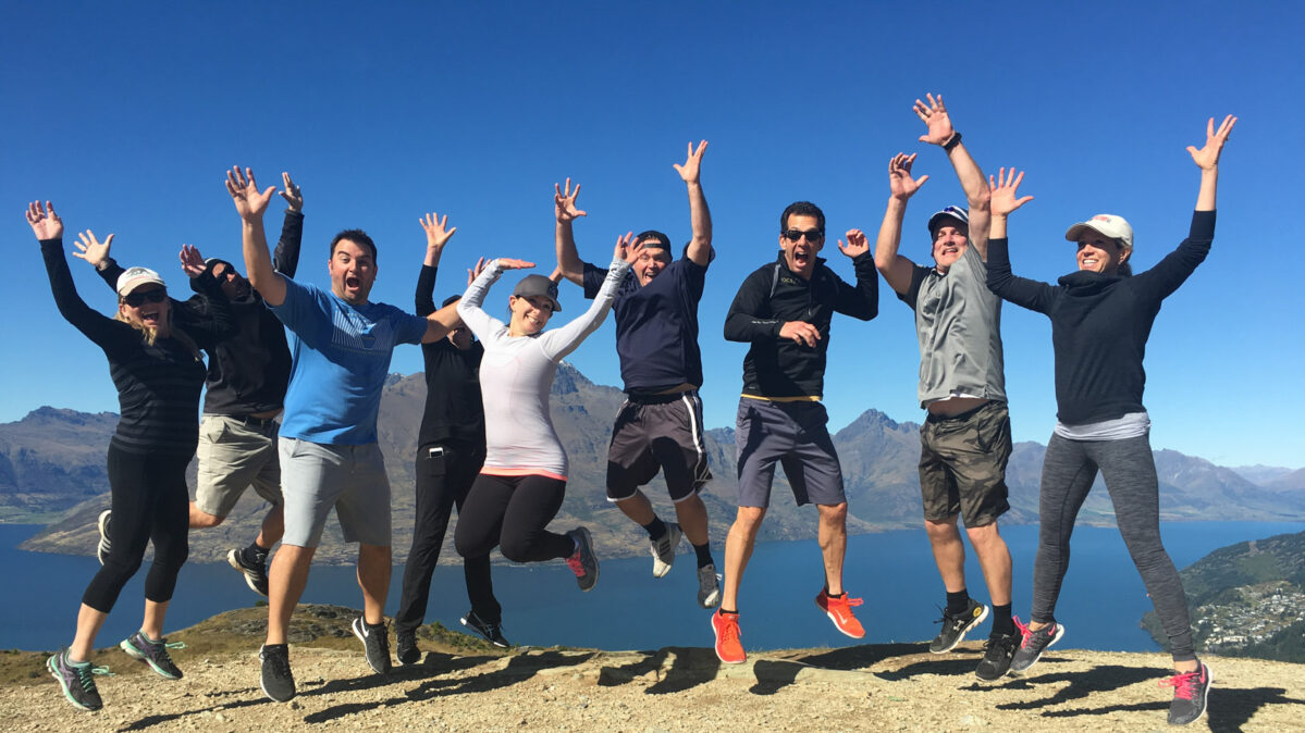 A group jumping in excitement.