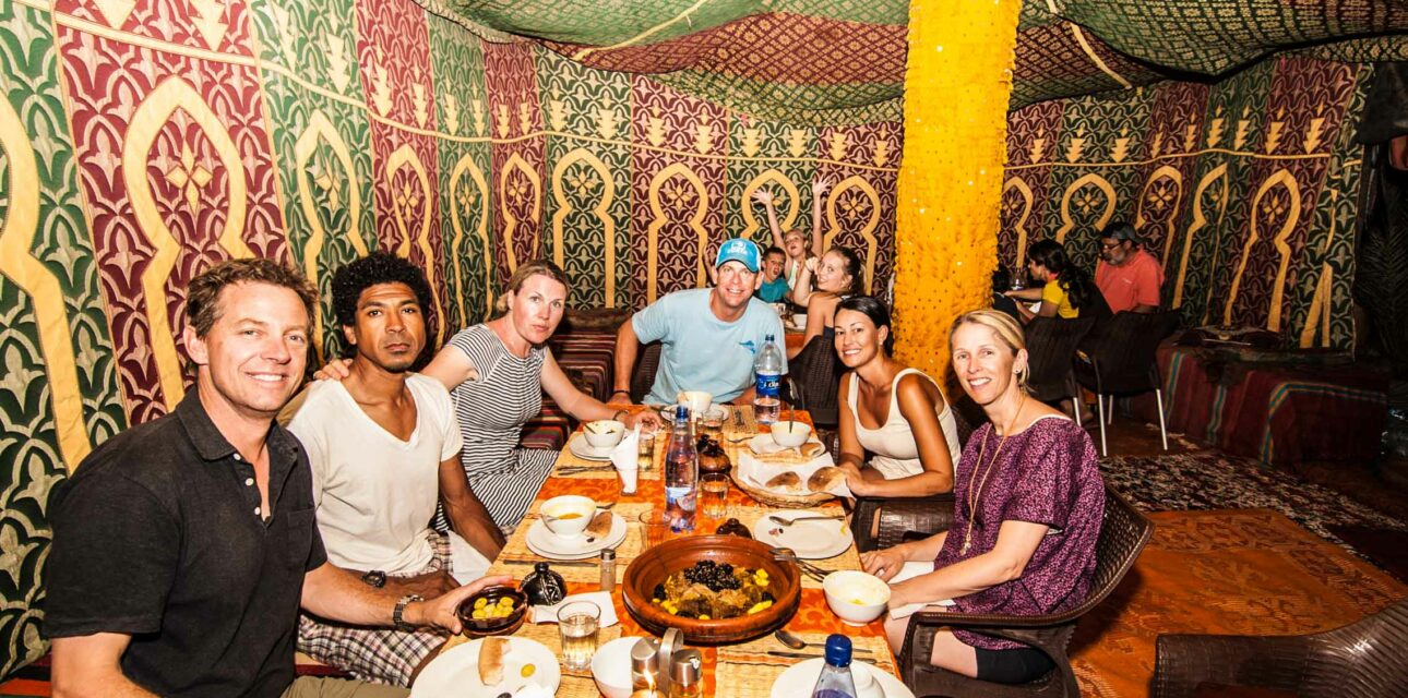 A group enjoying a meal in a tent.