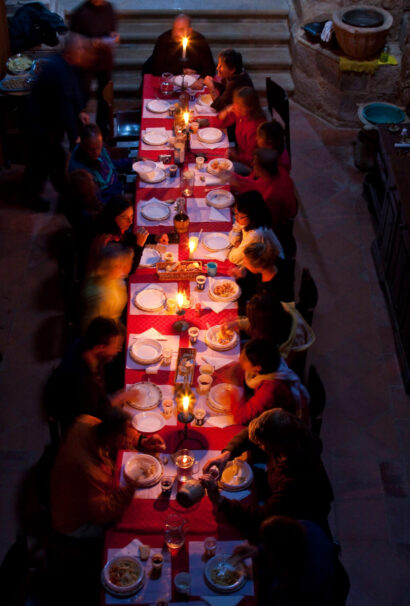 A group of people eating at a long table.