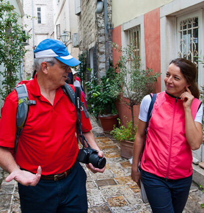 A tour gudie engaged with a tourist.