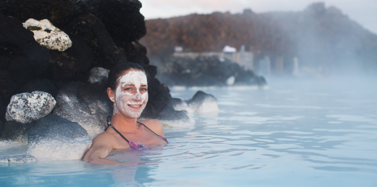 A woman in a hot spring in Iceland.