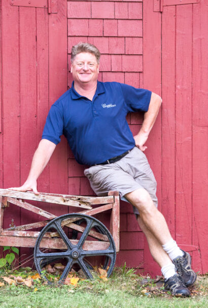Michael guide leaning on a barn.