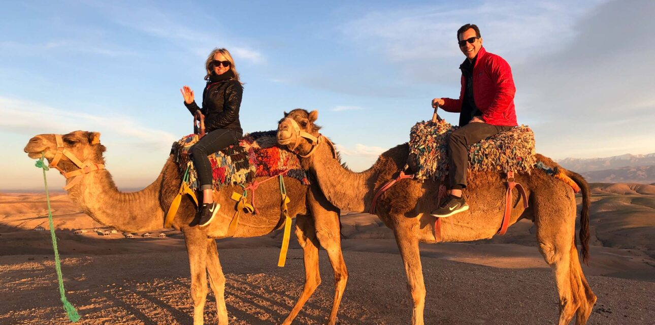 Two people on camels.