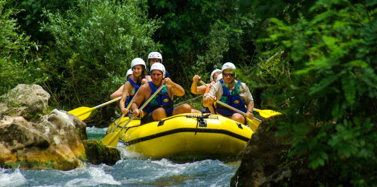A group white water rafting.