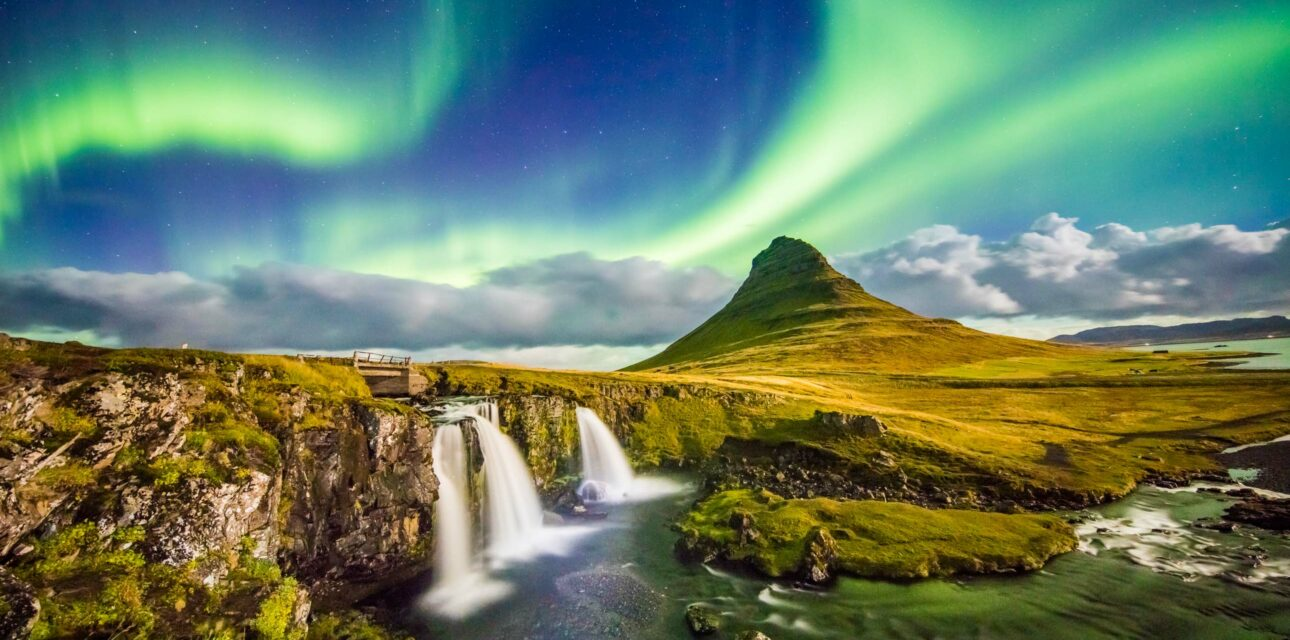European northern lights and waterfall.