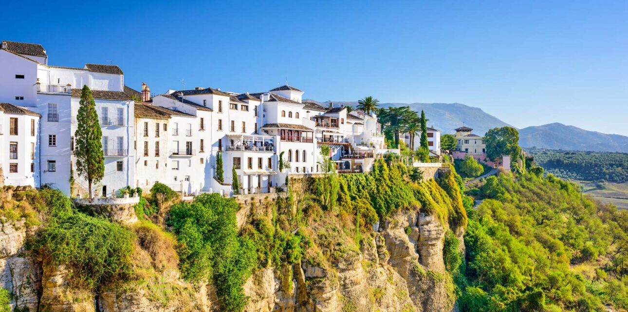 A cliff in Spain with white houses.