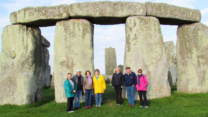 A group of tourists in front of Stonehenge.