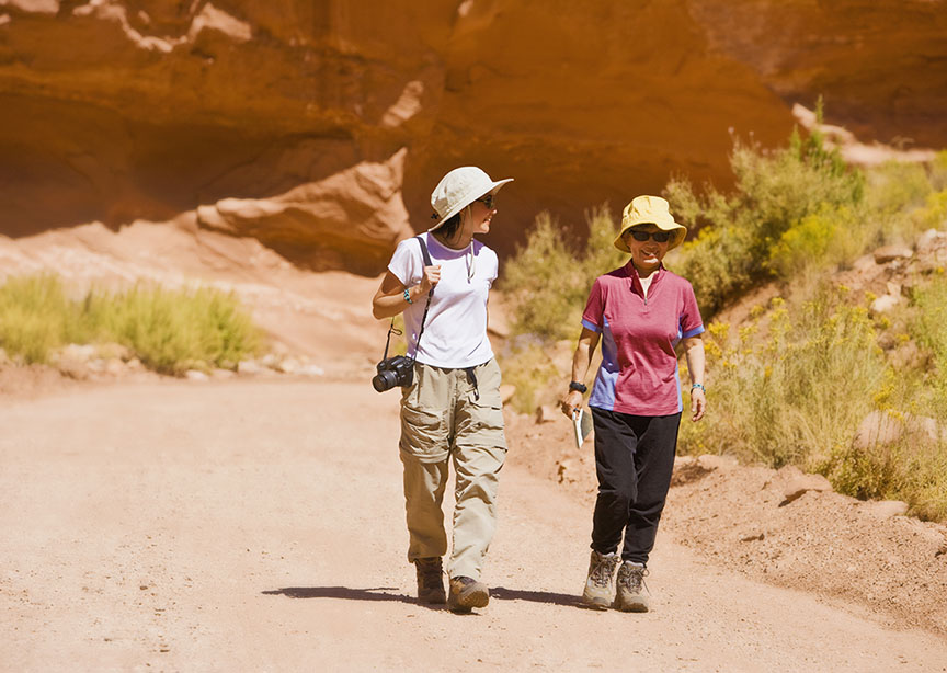 Two young travelers walking through national park