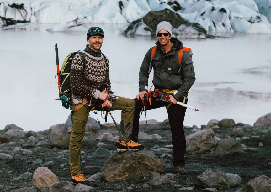 Iceland tour operator guides on glacier