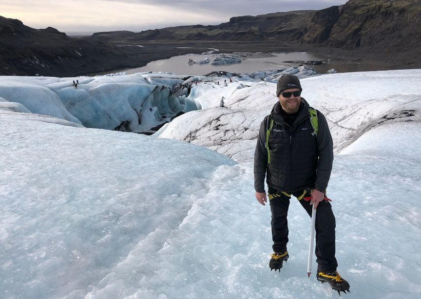 Iceland guide Alti standing on glacier