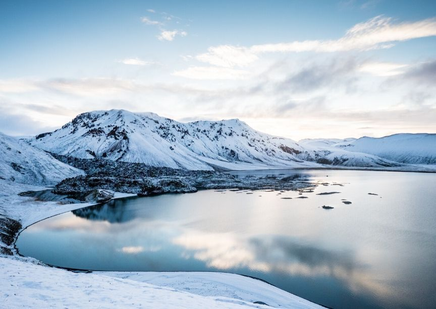 Iceland winter landscape snow on land and lake