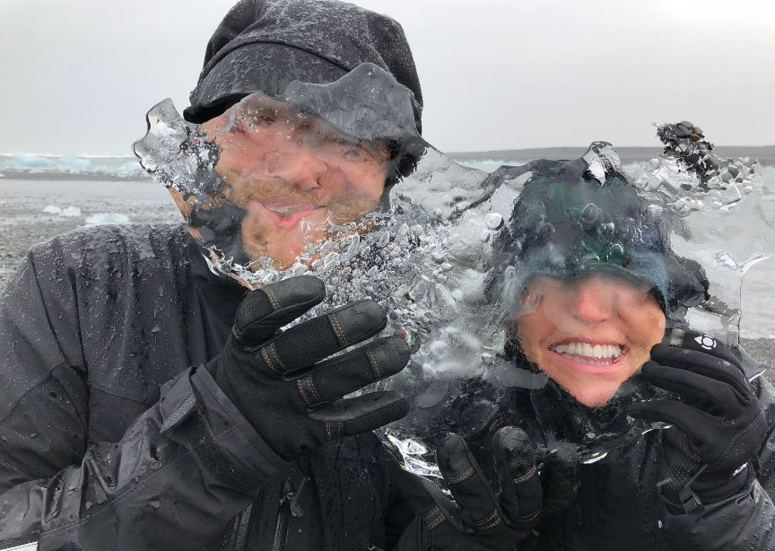 Iceland guide and guest smiling with ice on glacier